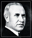 white man with short gray hair in a suit