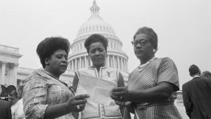 Three black women in front of Capitol Building
