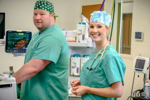 Two third year students in scrubs